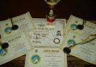 Виборені кубок та дипломи на ряді з сертифікатом на присвоєння ІІІ дану з РБ Гузову Сергію Миколайовичу
